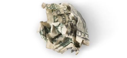 crumpled up dollar bill against white background